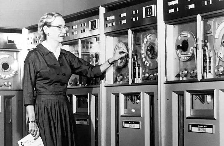 Grace Hoppper in the 1950s shown working on a computer