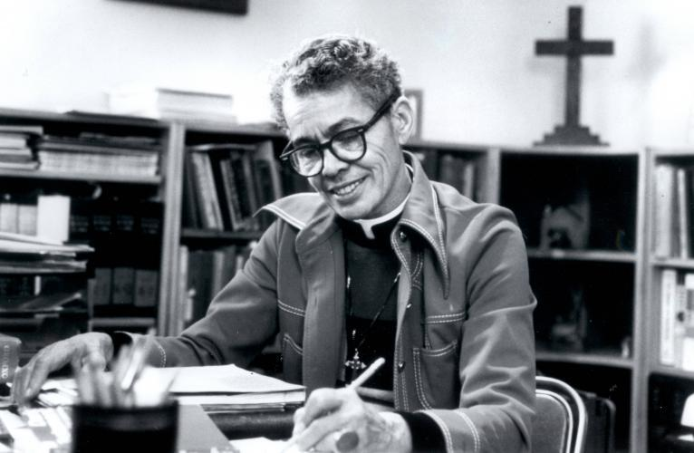 Pauli Murray sits at her desk writing circa 1970s